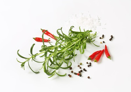 Rosemary, peppercorns and red chili peppers - studio shot