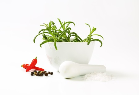 Fresh rosemary in a porcelain mortar