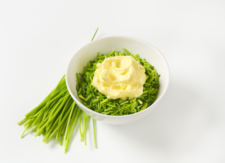 Chopped chives and butter in a bowl