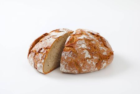 Loaf of rustic bread cut into halves Standard-Bild