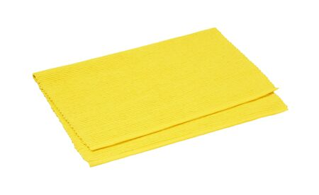 Yellow woven cotton place mat folded in half isolated on white