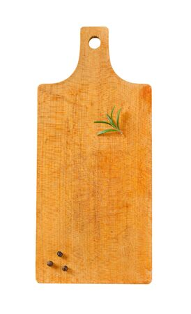 Wooden cutting board with rosemary and black peppercorns on it