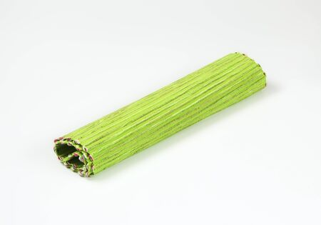 Rolled ribbed green place mat