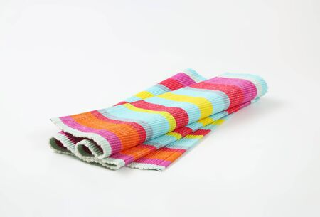 Colorful striped ribbed woven cotton place mat - folded