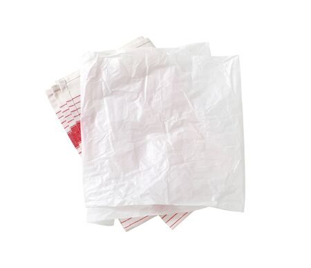 Creased sheet of white wax paper (butcher paper) on tea towel isolated on white Zdjęcie Seryjne