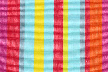 Colorful striped ribbed woven cotton place mat - background, full frame