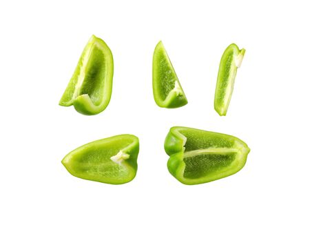 Green bell pepper cut into pieces isolated on white