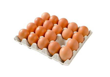 Carton of fresh brown eggs, one egg missing Standard-Bild