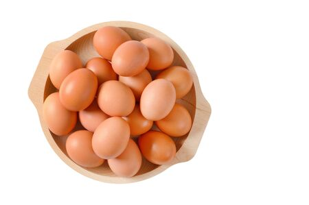 Fresh brown eggs in wooden bowl isolated on white Zdjęcie Seryjne