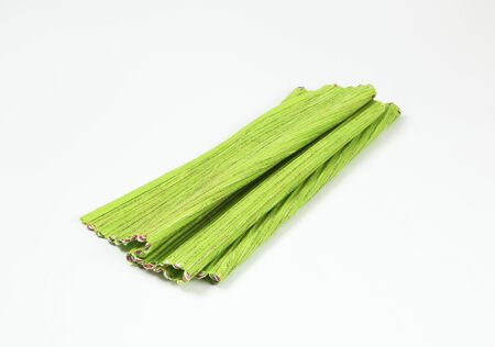 Folded ribbed green place mat Standard-Bild