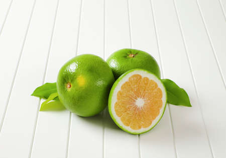 Two and a half sweetie fruits (green grapefruits, pomelits) and leaves