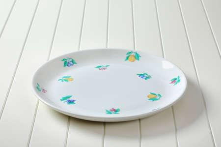 Empty breakfast plate with fruit print