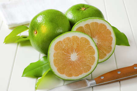 Sweetie fruits (green grapefruits, pomelits) - two whole fruits and slices