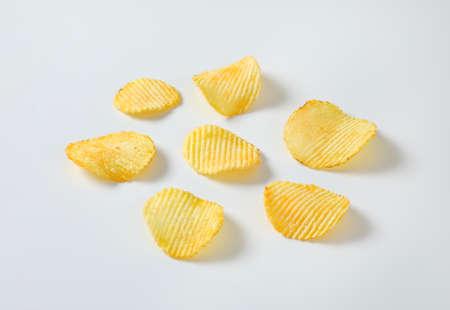 Six thin ridged potato chips