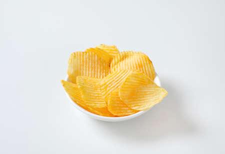 Bowl of thin ridged potato chips