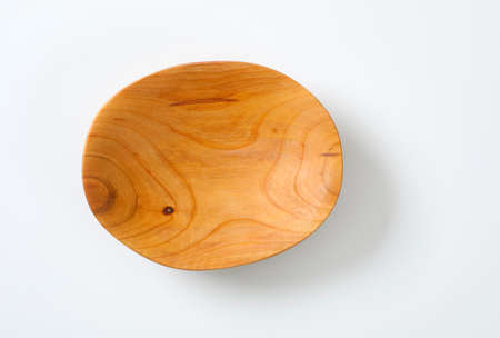 Empty oval shaped natural wood bowl