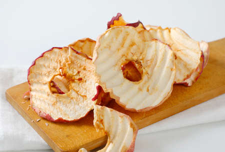Dried apple chips or rings on cutting board