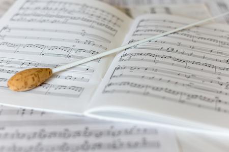 A natural conductors baton on orchestral score