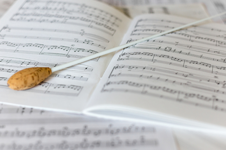 A natural conductors baton on orchestral score