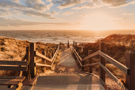 wooden pier with a sea view at sunset