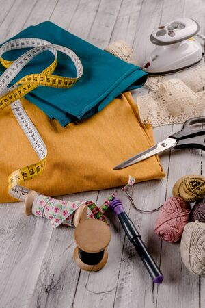 Colorful fabric with scissors, irons and wool for sewing
