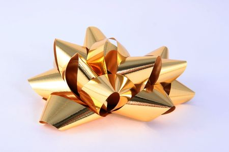 Gold holiday gift wrap bow photo