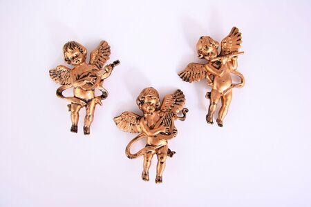 cherubs: Three angelic cherubs on white Stock Photo