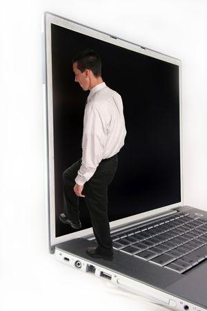 Business Man climbing into Laptop Computer Stock Photo - 297025