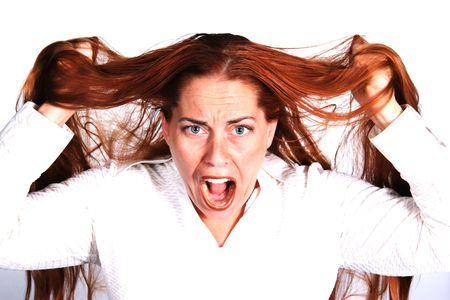 Crazy Woman Pulling Out Hair in Frustration photo