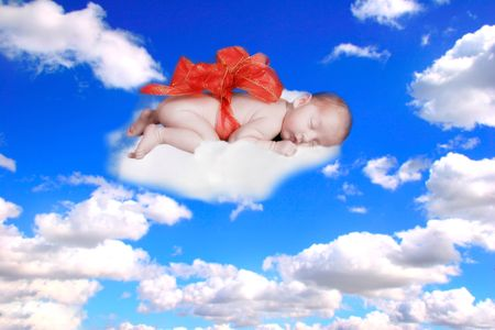 Infant Baby Fantasy Portrait in Clouds photo