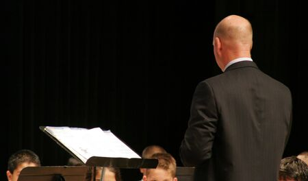 conducting: Band Director Conducting Music Concert Stock Photo