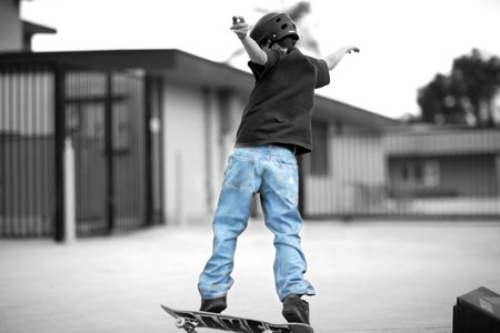 Young Boy With Skateboard Stock fotó