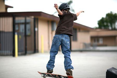 Boy Skateboarding Outdoors