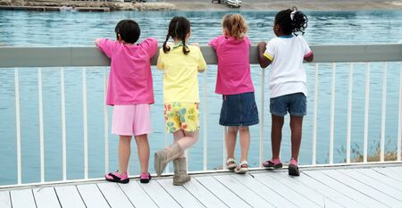amaze: Girls on a Dock Watching Boats Pass By