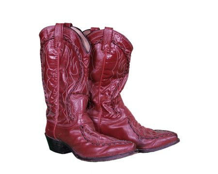 Red Leather Worn Country Boots Isolated on White photo