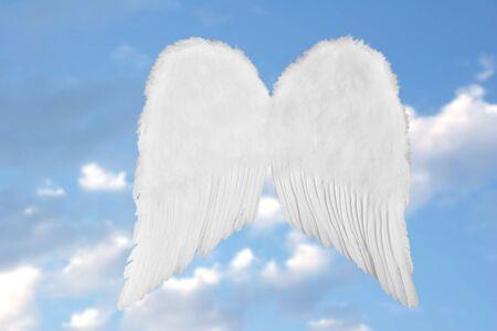 White Heavenly Angel Wings on Fantasy Sky Stock Photo
