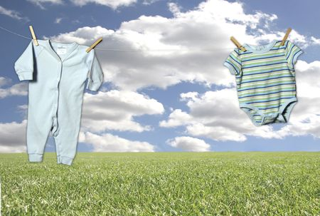 in insert: Outdoor Clothesline on a Fantasy Sky and Grass Background (Insert  in Outfit in Middle Hanging Adorably!) Stock Photo