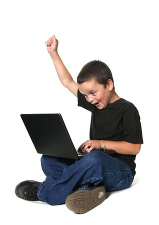 Excited Youth Working on Computer Stock Photo - 532516