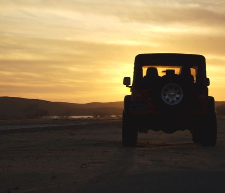 jeep: Offroad Vehicle Overlooking Water at Sunset