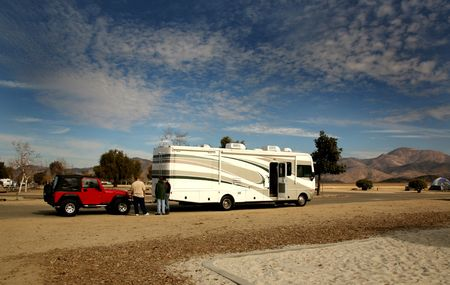 RV Coach Towing an Offroad 4X4 Vehicle Stock Photo
