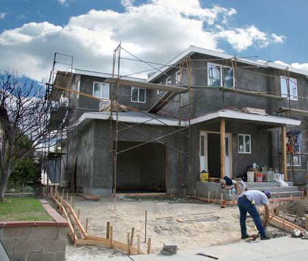 2x4: Residential Home Under Construction With Workers on the Job