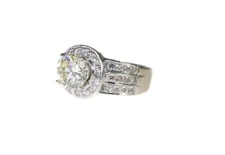 Platinum White Gold Diamond Wedding Engagement Ring With Band Isolated on White Background photo