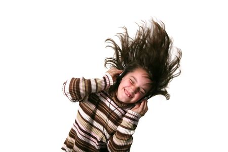 intentional: Kid Rocking to Music With Headphones: Intentional Motion Blur Stock Photo