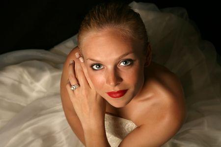 Beautiful Bride Against Dramatic Black Background photo