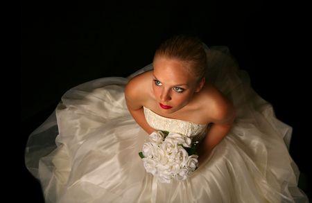 virgin girl: Beautiful Bride Against Dramatic Black Background Stock Photo