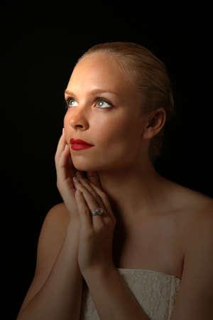 Beautiful Bride Against Dramatic Black Background Stock fotó