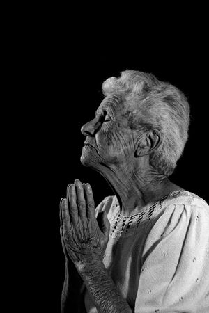 wise woman: Very Old Woman Praying to the Lord