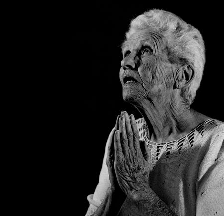 Praying Woman Looking up to the Lord Stock Photo