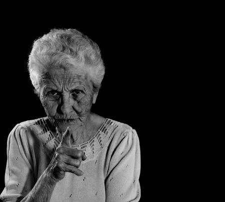 reprimanding: Stern Senior Citizen Pointing Her Finger and Reprimanding
