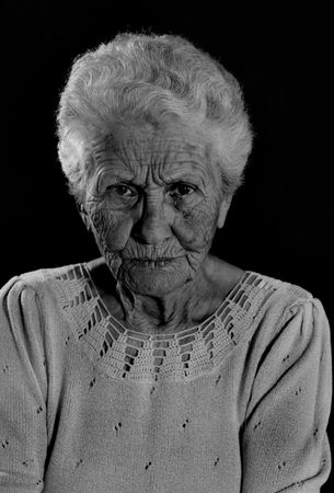 Very Old Wrinkled Woman With Stern Look on Her Face Stock Photo - 1216051